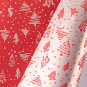 Tondi in polipropilene bicolor rosso con stampa alberelli. Vendita a confezione da 10 pezzi. Vendita all'ingrosso e online